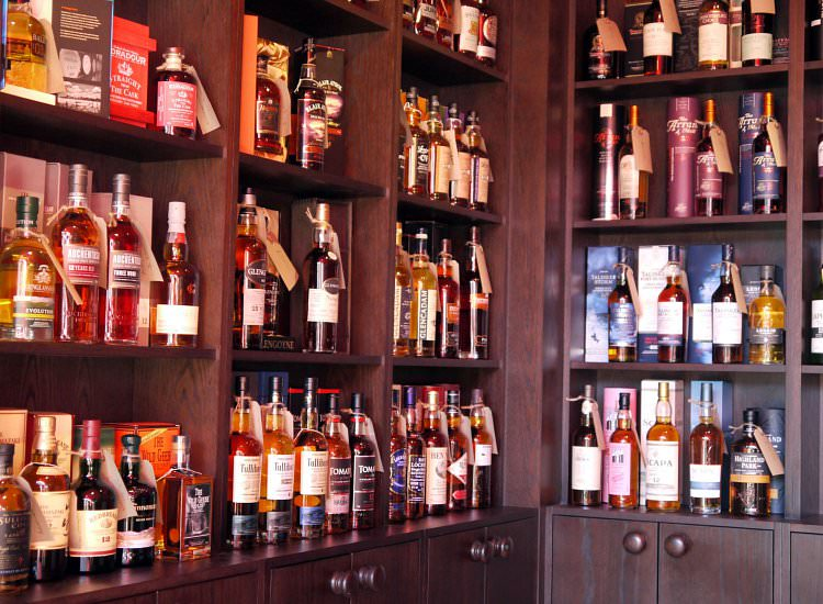 The Jar Whisky Shop Interior Troon. Whisky bottles on shelves.